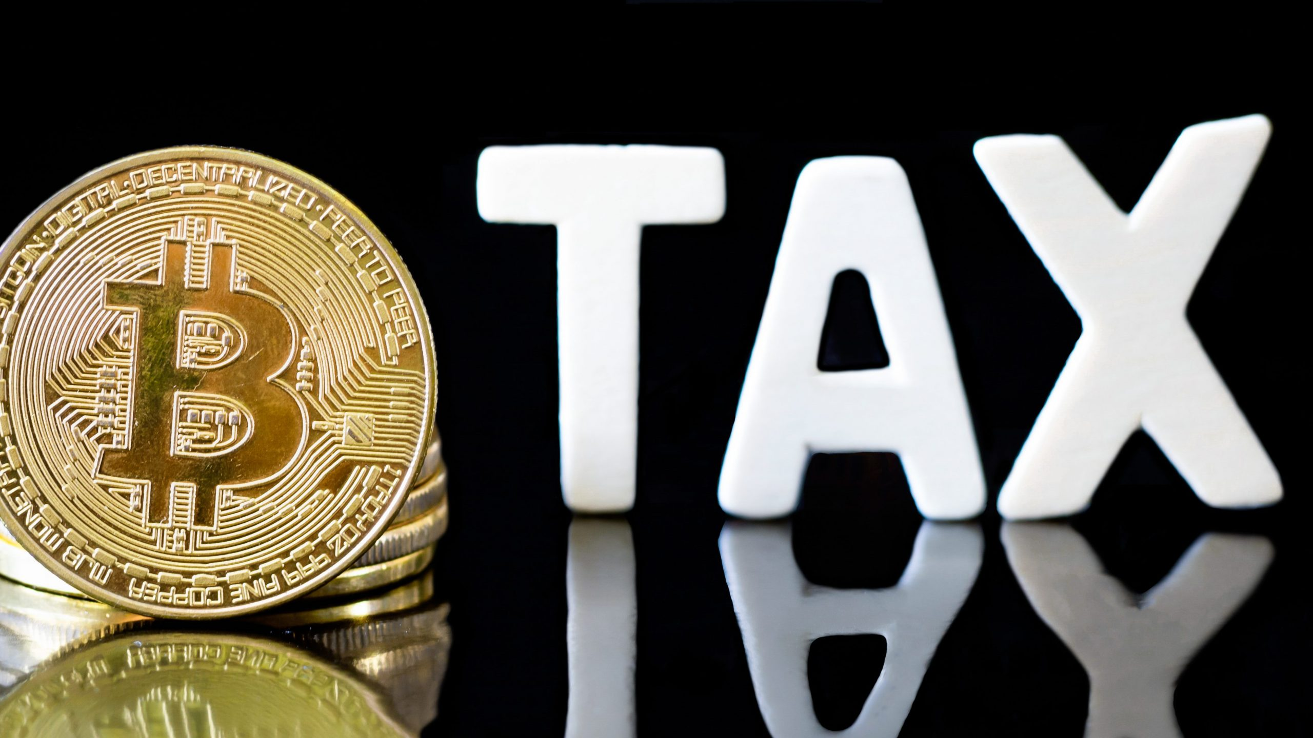 crypto-currency-bitcoin-coin-with-tax-message-concept-determining-tax-law-digital-money-1-3766x2119